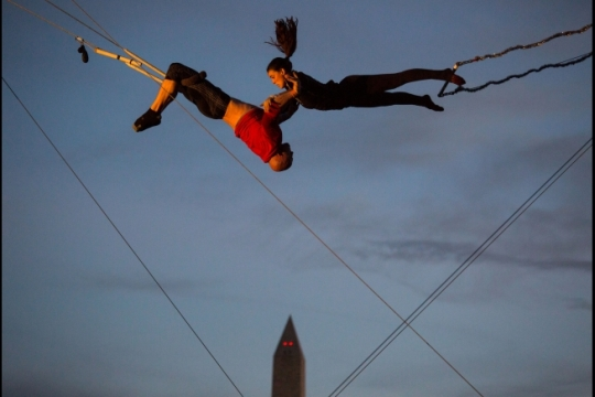 Oliver Parkinson and Lizzy Schwartz rehearse on a trapeze on the South Lawn, Oct. 29, 2015. They will be performing with other aerialists during the White House Halloween celebration Friday. (Official White House Photo by Pete Souza)