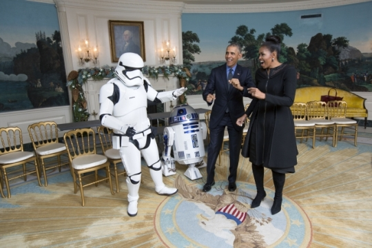 President Barack Obama and First Lady Michelle Obama dance with a Storm Trooper and R2-D2 from Star Wars in the Diplomatic Reception Room of the White House, Dec. 18, 2015. (Official White House Photo by Lawrence Jackson)