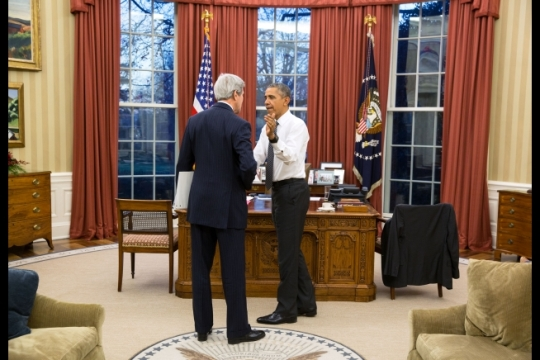 President Barack Obama greets Secretary of State John Kerry before their meeting in the Oval Office, Dec. 16, 2015. (Official White House Photo by Pete Souza)
