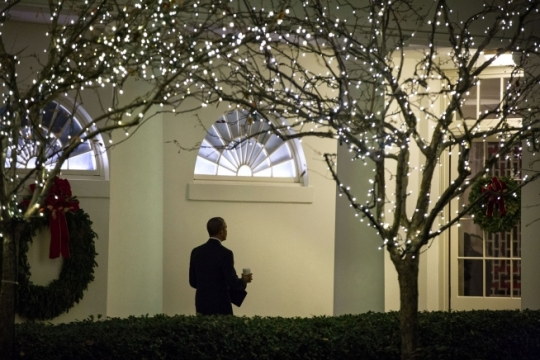 President Barack Obama walks along the White House colonnade after making a statement on the landmark climate change agreement reached earlier today in France, Saturday, Dec. 12, 2015. (Official White House Photo by Pete Souza)