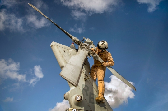 151229-N-DX365-043 GUAM (Dec. 29, 2015) Hospital Corpsman 3rd Class Curt Hanson, assigned to the Island Knights of Helicopter Sea Combat Squadron (HSC) 25, performs a pre-flight inspection on an MH-60S Sea Hawk helicopter before a photo exercise at Andersen Air Force Base, Guam. HSC- 25 maintains a 24-hour search and rescue and medical evacuation alert posture, directly supporting the U.S. Coast Guard, Sector Guam and Joint Region Marianas. HSC-25 ensures maritime peace and security in the U.S. 7th Fleet area of responsibility. (U.S. Navy photo by Chief Mass Communication Specialist Joan E. Jennings/Released)