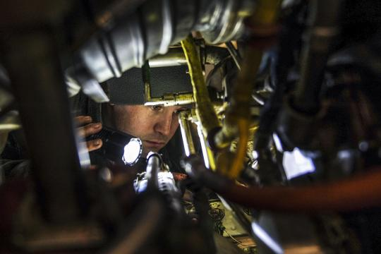 U.S. Air Force Staff Sgt. Michael White inspects the inside of a C-130J engine on Little Rock Air Force Base, Ark., Dec. 29, 2015. White, an aerospace propulsion journeyman assigned to the 19th Maintenance Squadron, ensured the engine was free from foreign object debris such as rubber, metal or leaves. U.S Air Force photo by Senior Airman Harry Brexel