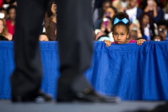 A young girl listens as President Barack Obama participates in a town hall discussion at McKinley High School in Baton Rouge, La., Jan. 14, 2016. (Official White House Photo by Pete Souza)