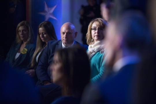 """Former Rep. Gabrielle """"Gabby"""" Giffords and her husband Capt. Mark Kelly listen to a question for President Barack Obama during a live CNN town hall event on reducing gun violence in America, at George Mason University in Fairfax, Va., Jan. 7, 2016. January 8th marks the anniversary of the 2011 shooting at a Tucson, Ariz., constituent event that left six dead and 13 injured, including Rep. Giffords, the target of the attack. (Official White House Photo by Pete Souza)"""