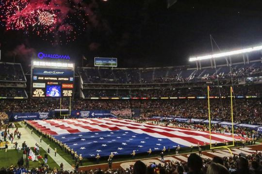 Marines unfurl the Holiday Bowl Big Flag during the bowl's pregame show in San Diego, Dec. 30, 2015. It takes a minimum of 250 people to present the 850-pound flag, which spans 100 yards by 50 yards and covers the entire field. The Marines are assigned to the 1st Marine Expeditionary Force on Marine Corps Base Camp Pendleton and Marine Corps Air Station Miramar. The University of Wisconsin Badgers beat the University of Southern California Trojans with a score of 23-21. U.S. Marine Corps photo by Lance Cpl. Caitlin Bevel