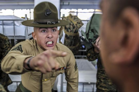 Marine Corps Sgt. Preston T. Brown instructs a recruit to respond louder at Marine Corps Recruit Depot in San Diego, Dec. 18, 2015. Annually, the depot trains more than 17,000 males recruited from the western recruiting region. U.S. Marine Corps photo by Sgt. Tyler Viglione