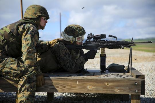 Marine Lance Cpl. Ethan Evans, left, instructs Lance Cpl. Jacob Levy on the automatic weapon range during comprehensive live-fire training on Camp Roberts, Calif., Jan 23, 2016. The Marines of 6th Air Naval Gunfire Liaison Company conducted firing exercises and machine gun ranges during the training.