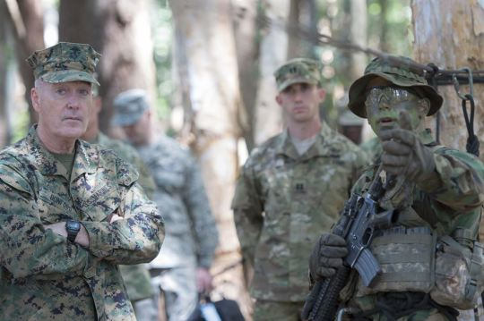 Marine Gen. Joseph F. Dunford Jr., chairman of the Joint Chiefs of Staff, speaks with an instructor at the 25th Infantry Division's Tropic Lightning Academy and Jungle Operations Training Center in Hawaii, Feb. 9th, 2016. The JOTC trains soldiers on survival, communication, navigation, waterborne and patrol base operations, in a jungle environment. DoD Photo by Navy Petty Officer 2nd Class Dominique A. Pineiro