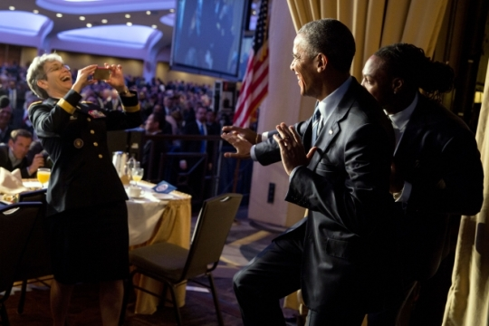 Maj. Gen. Julie A. Bentz photographs President Barack Obama and University of Alabama Heisman Trophy winner Derrick Henry as they strike a Heisman pose after the National Prayer Breakfast at the Washington Hilton in Washington, D.C., Feb. 4, 2016. (Official White House Photo by Pete Souza)
