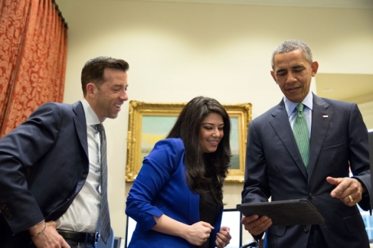 President Barack Obama watches his Lin Manuel Miranda rap video with Brian Mosteller, Director of Oval Office Operations, and Personal Aide Ferial Govashiri in the Outer Oval Office, March 15, 2016. (Official White House Photo by Amanda Lucidon)