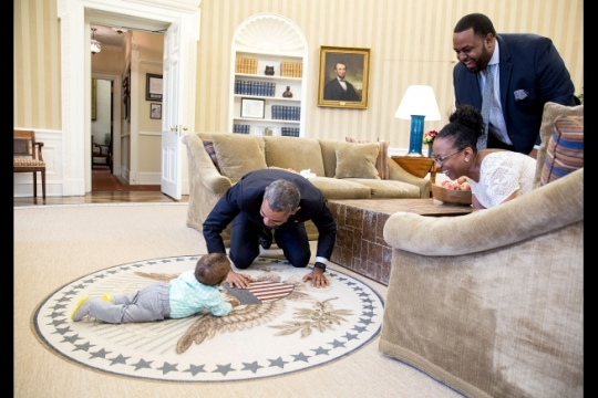 President Barack Obama plays with August DuBois during an Oval Office visit with his parents, Joshua and Michelle DuBois, April 11, 2016. Joshua is the former Executive Director of the White House Office of Faith-based and Neighborhood Partnerships. (Official White House Photo by Pete Souza)