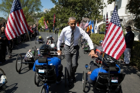 President Barack Obama greets participants in the Wounded Warrior Project's Soldier Ride after their lap around the South Lawn of the White House, April 14, 2016. (Official White House Photo by Pete Souza)