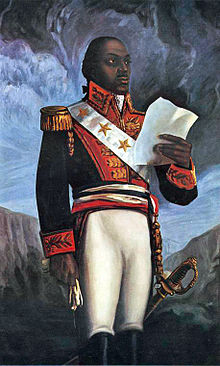 A painting of Louverture in a military uniform holding a document.  Photo Courtesy:  Wikipedia