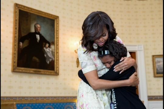 First Lady Michelle Obama embraces Keniya Brown, a guest invited by DC Child and Family Services Foster Care system, in the Blue Room prior to the Take Your Daughters and Sons to Work Day event in the East Room of the White House, April 20, 2016. (Official White House Photo by Amanda Lucidon)