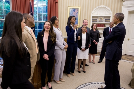 President Barack Obama and his Boys and Girls Clubs of America National Youth of the Year guests react to comments by Alora Kionne Allen, center, during a visit to the Oval Office, May 17, 2016. The Youth of the Year are, from left, Brooke Grand, Northeast; Courtney Patterson, Southwest; Emily Carvajal, Pacific; Rian-Simone Harris, National Military; Alora Kionne Allen, Midwest; Whitney Stewart, Southeast; along with club officials, Jim Clark, President and CEO; Julie Teer, Chief Development and Public Affairs; and Myron Gray, Board Chair-Elect. (Official White House Photo by Pete Souza)