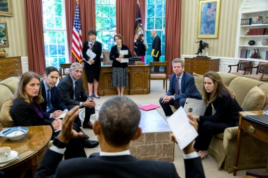President Barack talks with participants after convening a meeting in the Oval Office on the ongoing response to the Zika virus, May 20, 2016. Pictured clockwise from left: Health and Human Services Secretary Sylvia Mathews Burwell; Dr. Tom Frieden, Director of the Centers for Disease Control and Prevention; Dr. Anthony Fauci, Director of The National Institute of Allergy and Infectious Diseases at the National Institute of Health; Senior Advisor Valerie Jarrett; Cecilia Muñoz, Domestic Policy Council Director; Shaun Donovan, Director, Office of Management and Budget; and Amy Pope, Deputy Homeland Security Advisor. In the background, Vice President Joe Biden talks with Amy Rosenbaum, Director of Legislative Affairs. (Official White House Photo by Pete Souza)