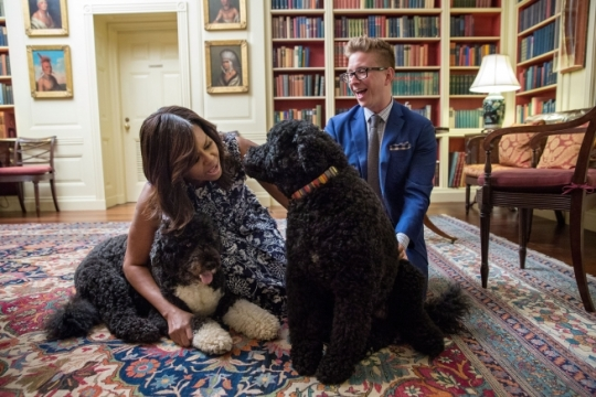 First Lady Michelle Obama and Tyler Oakley greet family pets Bo and Sunny in the Library of the White House, following the Beating the Odds Summit , July 19, 2016. (Official White House Photo by Amanda Lucidon)
