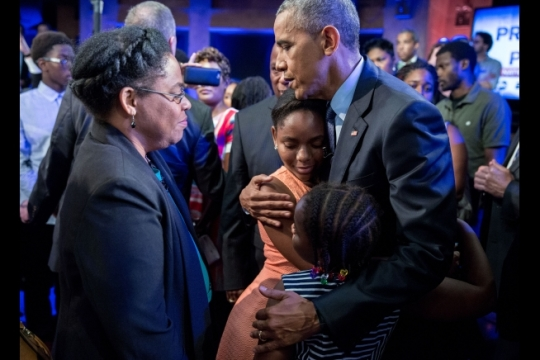 """President Barack Obama hugs Eliana Pinckney and her younger sister Malana Pinckney, daughters of Reverend Clementa Pinckney who was killed in the 2015 Charleston church shooting, after participating in """"The President and the People: A National Conversation,"""" an ABC/ESPN town hall on race and policing with David Muir, anchor of ABC's """"World News Tonight"""" at the Studio Theatre in Washington, D.C., July 14, 2016. The girls' mother, Jennifer Pinckney, watches at left. (Official White House Photo by Pete Souza)"""