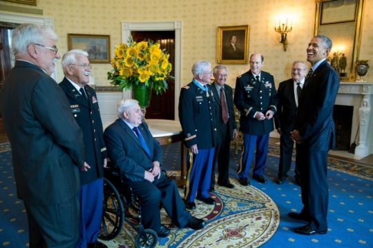 President Barack Obama talks with retired U.S. Army Lieutenant Colonel Charles Kettles, center, and his guests, former brothers-in-arms from Vietnam, in the Blue Room following the Medal of Honor ceremony for Kettles at the White House, July 18, 2016. Then-Major Kettles distinguished himself in combat operations near Duc Pho, Republic of Vietnam, on May 15, 1967, and is credited with saving the lives of 40 soldiers and four of his own crew members. (Official White House Photo by Pete Souza)