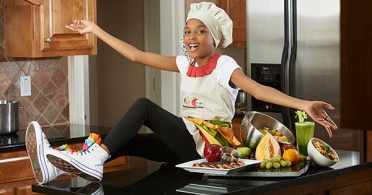 Shiona Shi Curry, author of S.N.A.C. it up! Cookbook: Shis Natural Approach to Cooking. Photo Courtesy: Blacknews.com