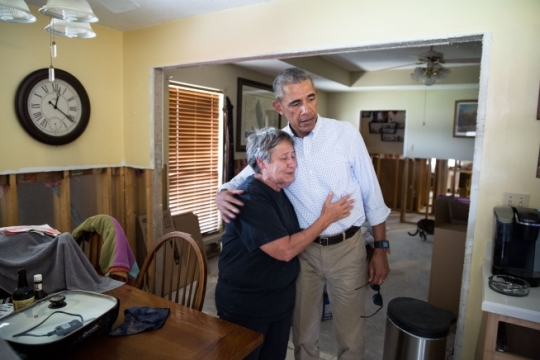 President Barack Obama hugs a home owner while viewing her flood-damaged home in the Castle Place subdivision in Zachary, near Baton Rouge, La., Aug. 23, 2016. (Official White House Photo by Pete Souza)
