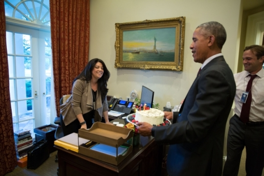 President Barack Obama presents Personal Aide Ferial Govashiri with an early birthday cake outside the Oval Office, Aug. 30, 2016. Govashiri's birthday comes while the President is traveling. (Official White House Photo by Pete Souza)