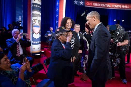 President Barack Obama returns a salute from a women who served during WW II during a CNN Town Hall moderated by Jake Tapper to discuss veterans, national security and foreign policy issues impacting the U.S. military, at the Clark Fitness Center at Fort Lee, Va., Sept. 28, 2016. (Official White House Photo by Pete Souza)