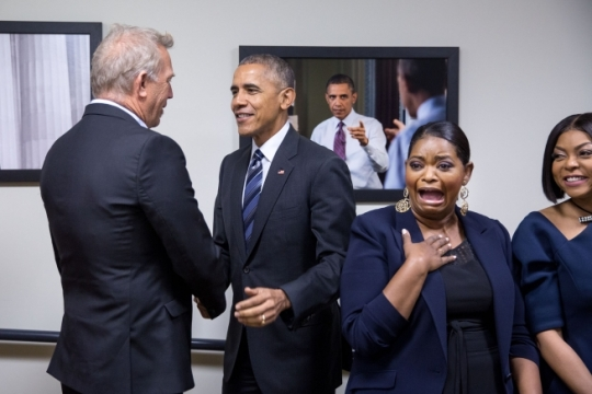 "President Barack Obama greets Kevin Costner after greeting Octavia Spencer, center, and Taraji P. Henson while dropping by for a surprise visit as the First Lady met with the cast of the film ""Hidden Figures"" prior to a screening of the film in the Eisenhower Executive Office Building South Court Auditorium, Dec. 15, 2016. (Official White House Photo by Pete Souza)"