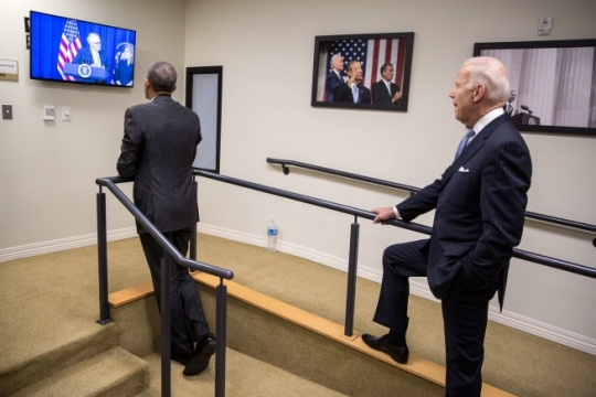 President Barack Obama and Vice President Joe Biden watch backstage as they are introduced by David and Kathy Grubb, for the H.R. 34 - 21st Century Cures Act bill signing ceremony in the Eisenhower Executive Office Building South Court Auditorium, Dec. 13, 2016. The Grubbs are Co-Founders of Jessa's Place, Charleston, W.Va. (Official White House Photo by Pete Souza)